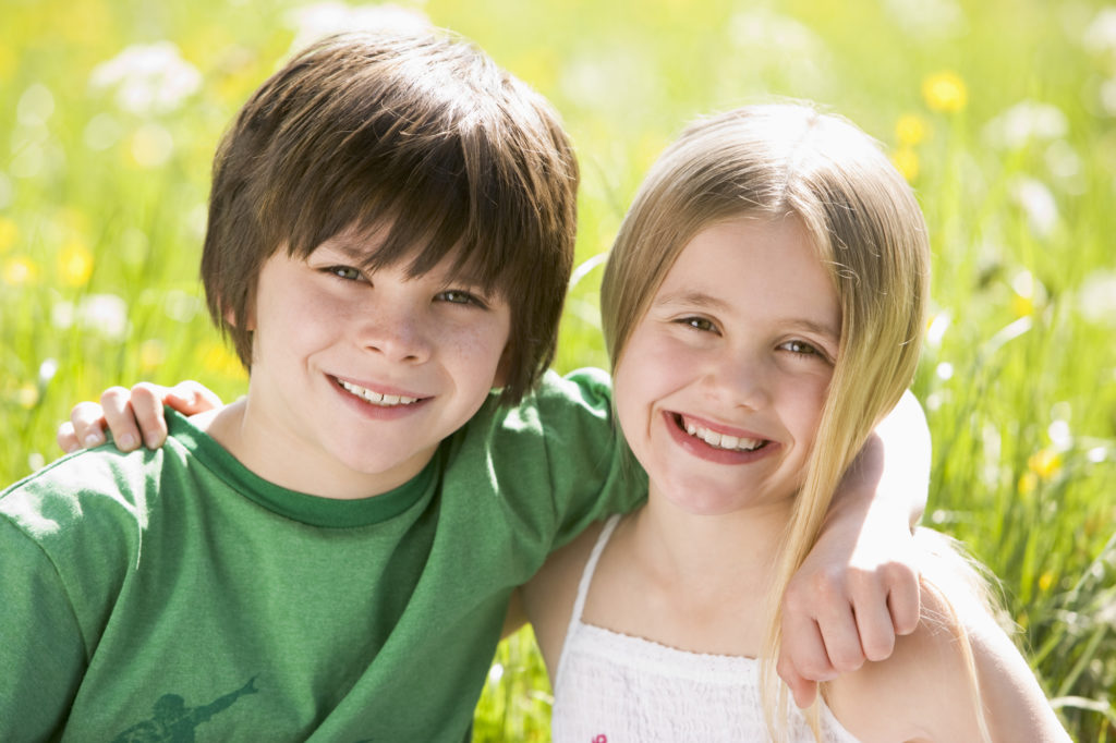 Brother and sister both with health smiles from kids dentistry services in Pleasanton, CA.