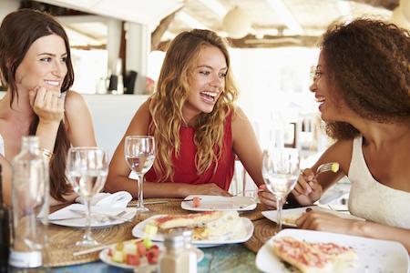 Three friends enjoy happy hour at Lokanta on Main St. in Pleasanton, CA.