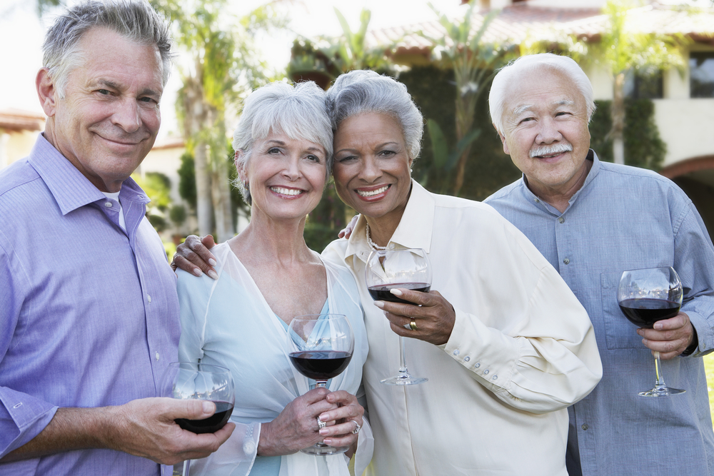 Older group of wine tasters are confident of their oral health and treatment for gum disease.