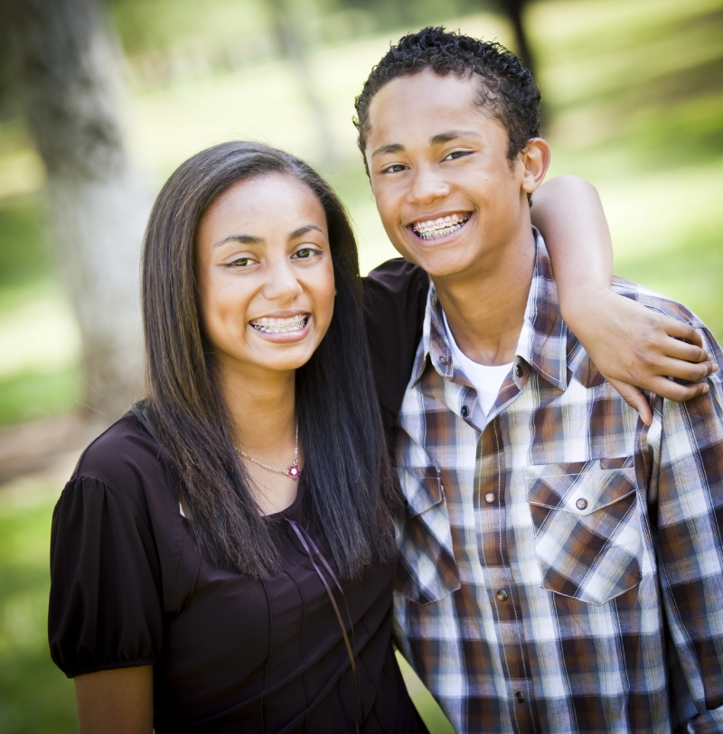 Brother and sister show off their braces from the menu of kids dentistry services at Amador Dental and Orthodontic in Pleasanton, CA.